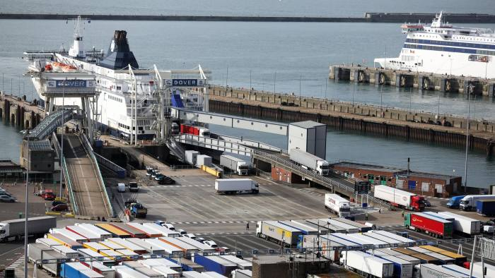 Lorries disembark from a DFDS AS ferry at the Port of Dover Ltd. in Dover, U.K., on Tuesday, Aug. 1, 2017. Customs checks at the border after the U.K. leaves the European Union could cost 1 billion pounds ($1.3 billion) a year and cause delays for goods being shipped in both directions, according to a report by Oxera, an economic consultancy. Photographer: Chris Ratcliffe/Bloomberg