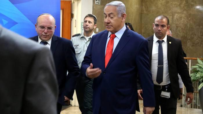 Israeli Prime Minister Benjamin Netanyahu (C) arrives to the weekly cabinet meeting at his Jerusalem office May 12, 2019. Gali Tibbon/Pool via REUTERS