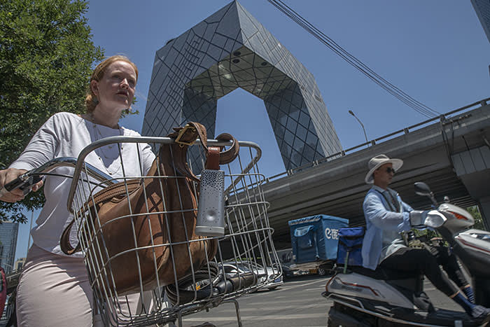Lucy Hornby cycling near the CCTV headquarters in Beijing's Central Business District