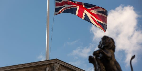 A British Union Flag, also know as a Union Jack, flies above the Bank of England (BOE) in the City of London, on Monday, June 20, 2016. British banks and their regulators are united in their hostility toward the European Union's bonus cap. Photographer: Jason Alden/Bloomberg