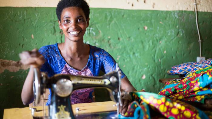 Way forward: a female entrepreneur works on her textiles in Rwanda's Gihembe camp