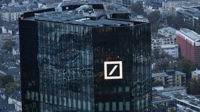 FILE: The Deutsche Bank AG logo sits on the bank's skyscraper headquarter offices in Frankfurt, Germany, on Monday, Oct. 13, 2015. Deutsche Bank AG is considering candidates to potentially replace Chief Executive Officer John Cryan amid heightened tensions between him and Supervisory Board Chairman Paul Achleitner, the Times of London reported without saying where it got the information. The bank approached Richard Gnodde, the head of Goldman Sachs Group Inc.'s international operations, but he's thought to have spurned the overture, the newspaper said. Deutsche Bank also considered UniCredit SpA CEO Jean Pierre Mustier and Standard Chartered Plc CEO Bill Winters, according to the report. Our editors select the best archive images for the Deutsche story. Photographer: Martin Leissl/Bloomberg