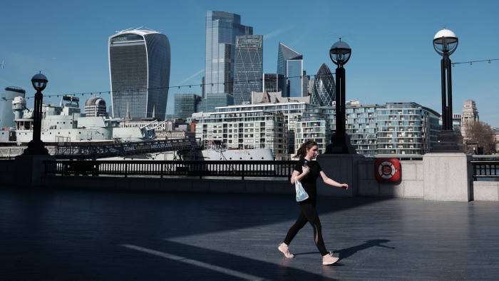 A woman walking along the Thames path near City Hall, London, the day after Prime Minister Boris Johnson put the UK in lockdown to help curb the spread of the coronavirus. PA Photo. Picture date: Tuesday March 24, 2020. See PA story HEALTH Coronavirus. Photo credit should read: Yui Mok/PA Wire