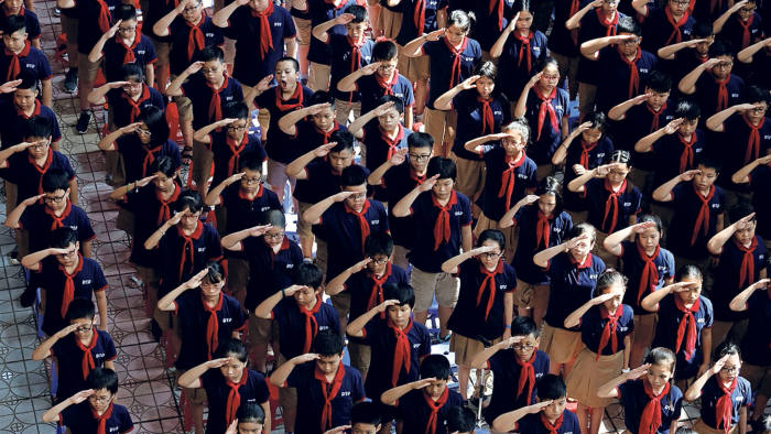 Vietnamese students salute as they attend the annual new school year ceremony at Doan Thi Diem secondary school in Hanoi, Vietnam September 5, 2018. REUTERS/Kham - RC194EBF0D70