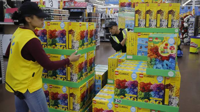 Jayln Martin, left, and Dan Villegas stock items in preparation for a holiday sale at a Walmart Supercenter, Wednesday, Nov. 27, 2019, in Las Vegas. Black Friday once again kicks off the start of the holiday shopping season. But it will be the shortest season since 2013 because of Thanksgiving falling on the fourth Thursday in November, the latest possible date it can be. (AP Photo/John Locher)
