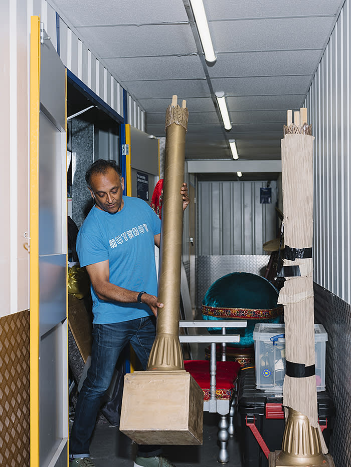 Ajay Chhabra, from Nutkhut, sorting out the items stored in their self-storage unit, Safestore Self Storage, Charlton, London, photographed for FT Magazine, July 2018