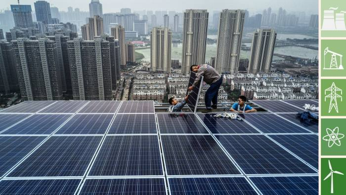WUHAN, CHINA - MAY 15: Chinese workers from Wuhan Guangsheng Photovoltaic Company work on a solar panel project on the roof of a 47 story building in a new development on May 15, 2017 in Wuhan, China. China consumes more electricity than any other nation, but it is also the world's biggest producer of solar energy. Capacity in China hit 77 gigawatts in 2016 which helped a 50% jump in solar power growth worldwide. China is now home to two-thirds of the world's solar production, though capacity and consumption remain low relative to its population. Still, the country now buys half of the world's new solar panels Ñ which convert sunlight into energy, and are being installed on rooftops in cities and across sprawling fields in rural areas. Greenpeace estimates that by 2030, renewable energy could replace fossil fuels as China's primary source of power, a significant change in a country considered the world's biggest polluter. China's government has officially committed to development of renewable energies to ease the countryÕs dependence on coal and other fossil fuels, though its strategic investments in the solar panel have created intense global competition. (Photo by Kevin Frayer/Getty Images)