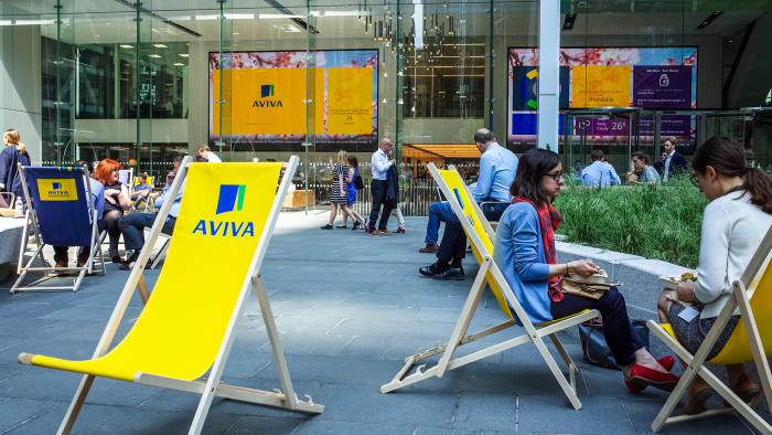 MM1JRB Aviva London - Aviva sponsored deck chairs outside the Aviva St Helen's building, formerly the Aviva Tower, in St Mary Axe in the City of London.