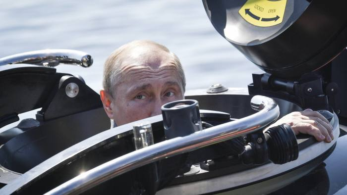 Russian President Vladimir Putin prepares to dive to the bottom of the Gulf of Finland aboard a C-Explorer 3.11 submersible to explore the Soviet Shchuka-class submarine Shch-308 sunken during World War II near the island of Gogland, Russia, on Saturday, July 27, 2019. (Alexei Nikolsky, Sputnik, Kremlin Pool Photo via AP)