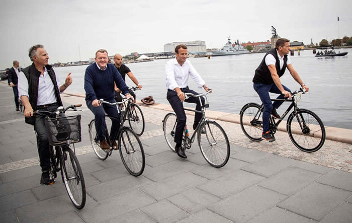 """TOPSHOT - A handout photo released by the Danish Prime Minister's office shows French President Emmanuel Macron (2ndR) and Denmark's Prime Minister Lars Lokke Rasmussen (2ndL) riding bicycles during a tour of the city on August 29, 2018 in Copenhagen. (Photo by HO / Danish Prime Minister's office / AFP) / RESTRICTED TO EDITORIAL USE - MANDATORY CREDIT """"AFP PHOTO / Danish Prime Minister's office"""" - NO MARKETING NO ADVERTISING CAMPAIGNS - DISTRIBUTED AS A SERVICE TO CLIENTSHO/AFP/Getty Images"""