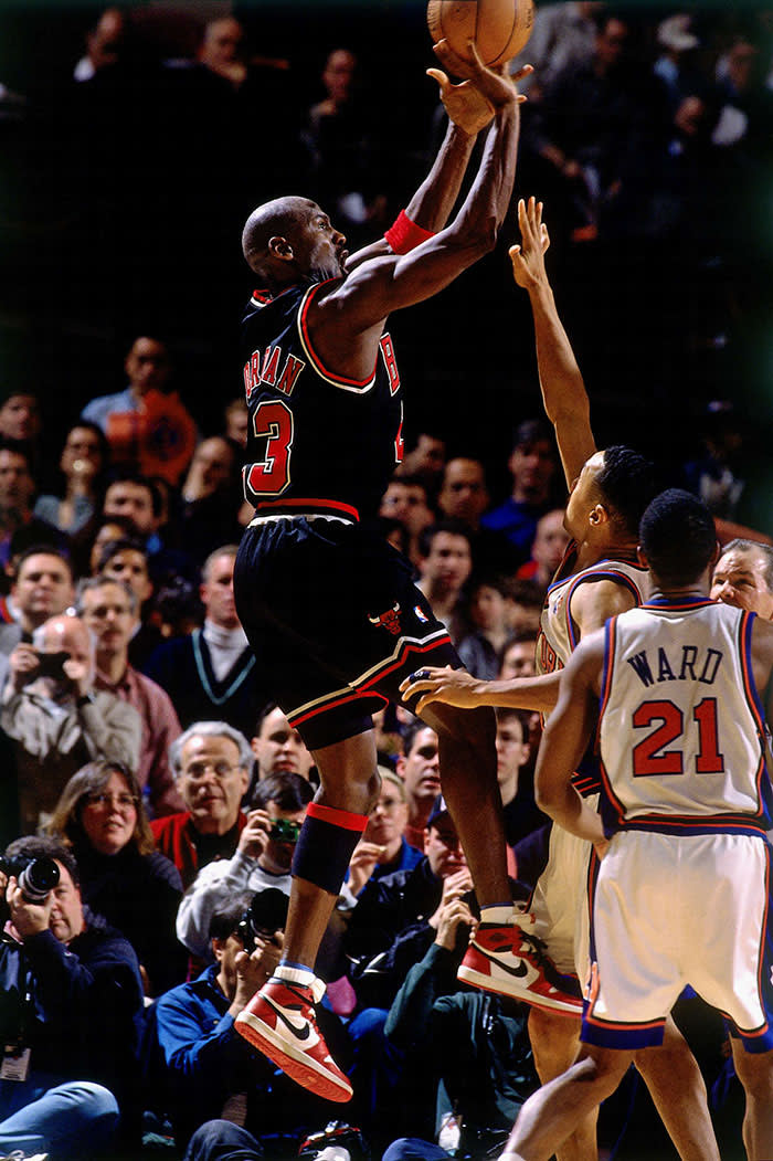 NEW YORK - MARCH 8: Michael Jordan #23 of the Chicago Bulls goes up for a shot wearing his original Nike sneakers against the New York Knicks during his final game at Madison Square Garden on March 8, 1998 in New York, New York. NOTE TO USER: User expressly acknowledges that, by downloading and or using this photograph, User is consenting to the terms and conditions of the Getty Images License agreement. Mandatory Copyright Notice: Copyright 1998 NBAE (Photo by Nathaniel S. Butler/NBAE via Getty Images)
