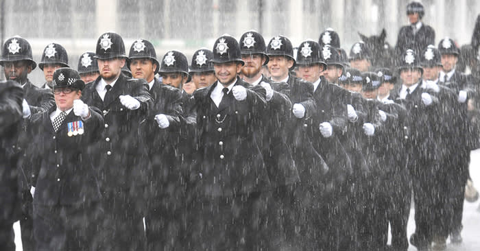 PABest New Metropolitan police officers brave pouring rain at a Passing Out parade for around 70 new officers, and candidates who have come through the Detective Constable fast-track scheme, Metropolitan Police Centre, north London. PRESS ASSOCIATION Photo. Picture date: Friday August 10, 2018. Photo credit should read: John Stillwell/PA Wire