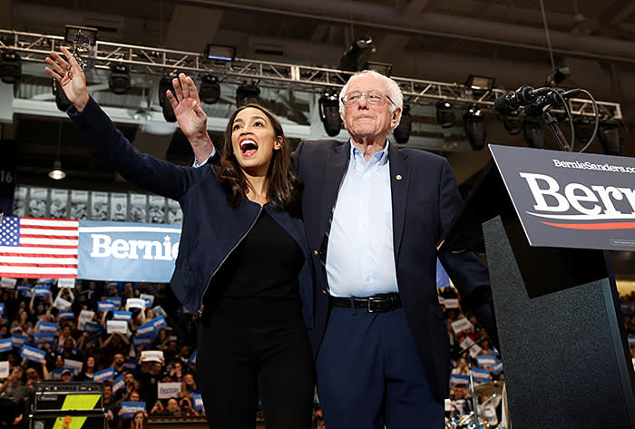 Bernie Sanders at a campaign rally last month with Alexandria Ocasio-Cortez. The 30-year-old congresswoman from New York may now pick up the Vermont senator's torch