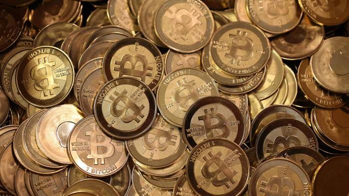 A pile of Bitcoin slugs sit in a box ready to be minted by Software engineer Mike Caldwell in his shop in Sandy, Utah on April 26 2013