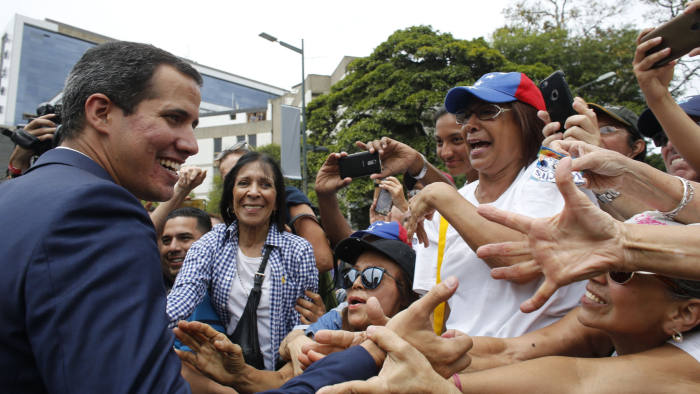 Opposition leader and self-proclaimed interim president of Venezuela Juan Guaido greets supporters at the end of a rally in Caracas, Venezuela, Tuesday, July 23, 2019. The National Assembly approved on Tuesday the return of Venezuela to the Inter-American Treaty of Reciprocal Assistance to strengthen cooperation with the countries of the region and raise pressure on President Nicolas Maduro. (AP Photo/Ariana Cubillos)
