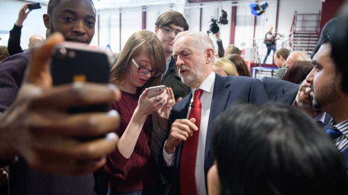 COVENTRY, ENGLAND - FEBRUARY 26: Labour leader Jeremy Corbyn (C) poses for selfies after making a keynote speech to set out Labour's position on Brexit, at the National Transport Design Centre on February 26, 2018 in Coventry, England. Jeremy Corbyn's Brexit speech confirmed that a Labour Government would negotiate full tariff-free access to EU markets for UK business. (Photo by Leon Neal/Getty Images)