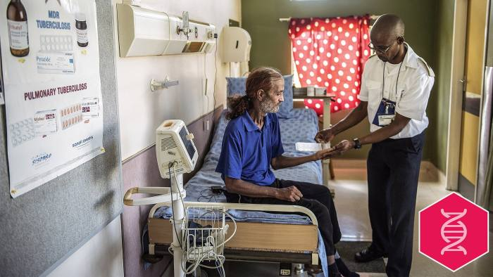 Former Tuberculosis affected patient Ashley McQuire receives his medication from a nurse at the Tshepong Hospital Tubercolosis ward on March 12, 2015 in Klerksdorp. He is one he first patients to have survived Extra Drugs Resistant (XDR) TB and he will leave the facility at the end of March. AFP PHOTO / MUJAHID SAFODIEN (Photo credit should read MUJAHID SAFODIEN/AFP/Getty Images)