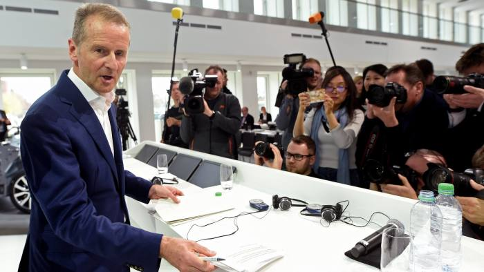 FILE PHOTO: Herbert Diess, CEO of German carmaker Volkswagen is surrounded by media during the annual news conference at the Volkswagen plant in Wolfsburg, Germany March 12, 2019. REUTERS/File Photo