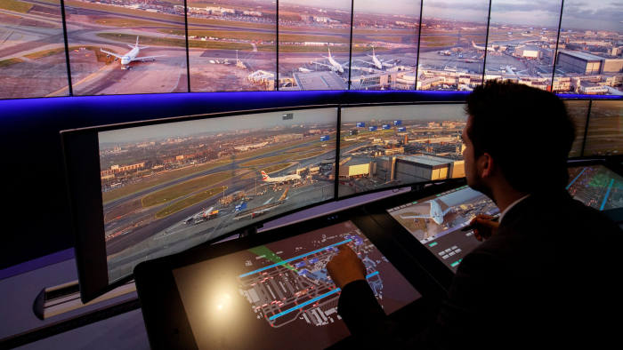 Air Traffic Control Engineers use screens displaying real-time panoramic views of the runways and docking gates, as they work on a non-operational trial in the NATS Digital Tower Laboratory, inside the control tower at London Heathrow Airport in west London on January 23, 2019. - Air traffic management service NATS has begun a trial at Heathrow Airport, to test if the use of ultra HD 4K cameras combined with Artificial Intelligence (AI) and machine learning technology, could be used to help improve the airport's landing capacity in times of low visibility, and improve punctuality. (Photo by Tolga Akmen / AFP)        (Photo credit should read TOLGA AKMEN/AFP/Getty Images)