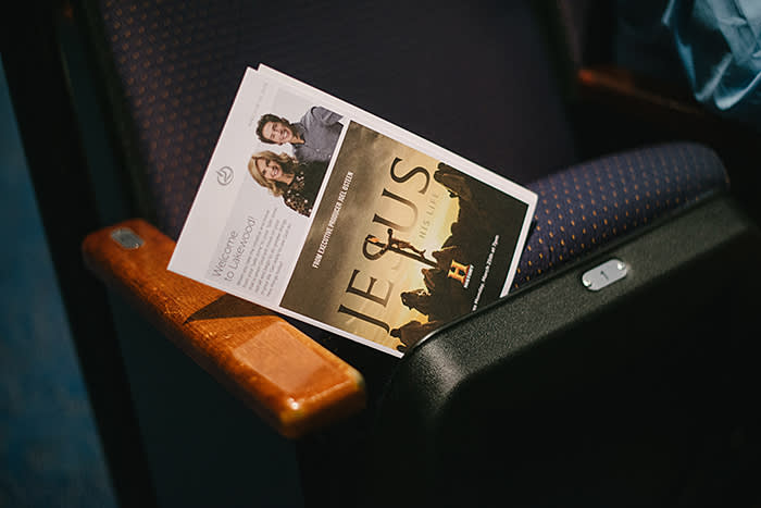 A pamphlet advertising a History Channel TV production about Jesus Christ that Joel Osteen is executive producing, left on a seat in the church