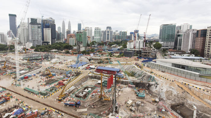 KUALA LUMPUR, MALAYSIA - JULY 30: General view of the Tun Razak Exchange project site on July 30, 2018 in Kuala Lumpur, Malaysia. The Tun Razak Exchange, one of the 1MDB projects, spans 70-acre in the heart of Kuala Lumpur. Malaysia's former prime minister Najib Razak has been under investigation for the 1Malaysia Development Berhad (1MDB) scandal, which dated back to 2009 and described as the biggest corruption scandal in Malaysian history, involving billions of dollars being embezzled from the government fund used to fund both Najib and his wife's lavish spending habits. Recent investigations have suggested involvement of the Chinese as $681 million of 1MDB money went into Najib's personal bank account and spent in at least six countries, including Singapore, Switzerland and the United States. Najib started 1MDB when he took power in 2009 and allegations began three years ago but his arrest came after 92-year-old Mahathir Mohamad reopened investigations and prosecution for money-laundering, pledging to bring justice to all responsible for the multibillion-dollar fraud. (Photo by Ore Huiying/Getty Images)