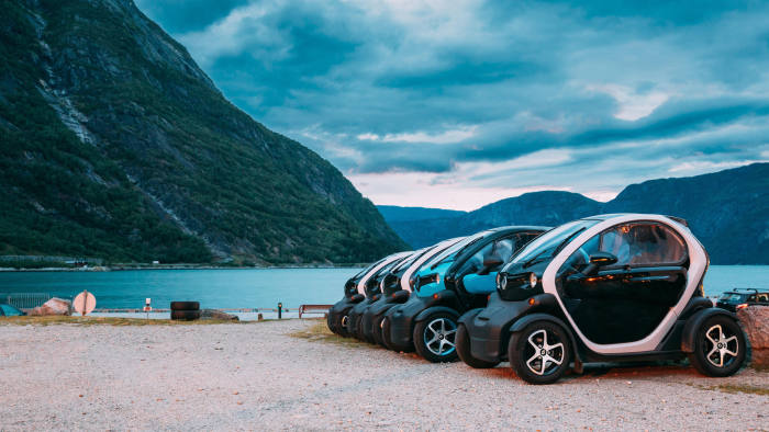 2A12CA4 Eidfjord, Norway - June 13, 2019: Many Black And Blue Colors Renault Z.E. Cars Parked In row. The Renault Z.E. or Zero Emission is a line of all-elec