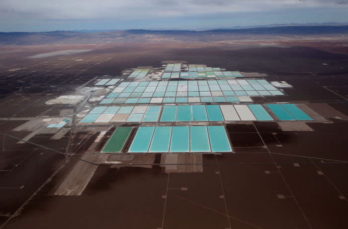 An aerial view shows the brine pools of SQM lithium mine on the Atacama salt flat in the Atacama desert of northern Chile, January 10, 2013. Picture taken January 10, 2013. REUTERS/Ivan Alvarado - RC1FE8C73F10