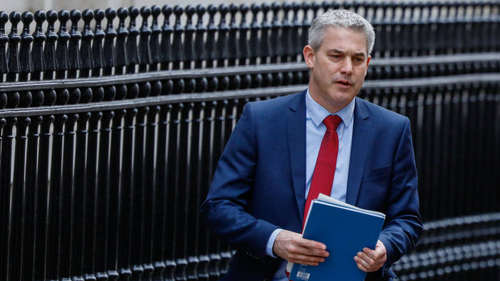Stephen Barclay, U.K. exiting the European Union (EU) secretary, departs Downing Street to attend a weekly questions and answers session in Parliament in London, U.K., on Wednesday, March 27, 2019. U.K. Prime Minister Theresa May aims to put her twice-defeated Brexit deal to another vote this week, amid signs some Brexit hardliners might be willing to back it. Photographer: Luke MacGregor/Bloomberg