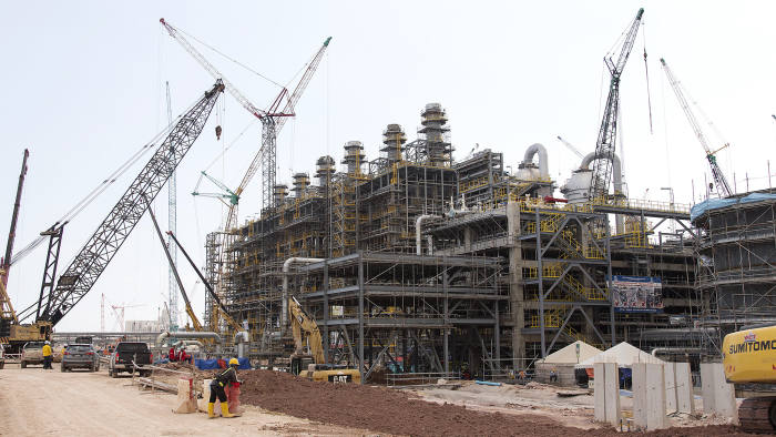Cranes operate at a steam cracker unit at the under construction Petronas Nasional Berhad (Petronas) Refinery and Petrochemical Integrated Development (Rapid) Project, part of the Pengerang Intergrated Complex PIC), in Johor, Malaysia, on Thursday, March 15, 2018. The Pengerang refining complex is