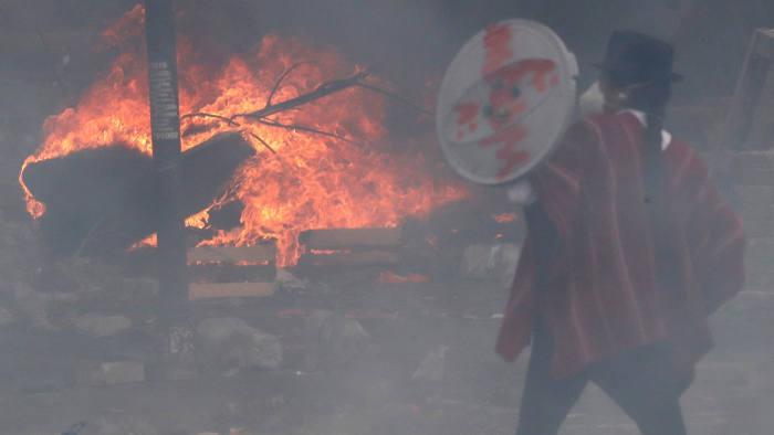 A demonstrator uses a shield during a protest against Ecuador's President Lenin Moreno's austerity measures in Quito, Ecuador October 12, 2019. REUTERS/Henry Romero