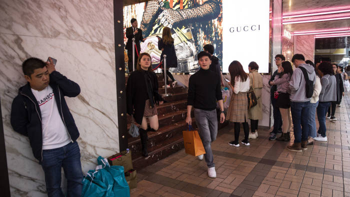 Shoppers wait in line outside a Guccio Gucci SpA store on Canton Road in the Tsim Sha Tsui district of Hong Kong, China, on Thursday, Dec. 20, 2018. Hong Kong's consumer price index (CPI) for November rose 2.6 percent year on year. Photographer: Justin Chin/Bloomberg