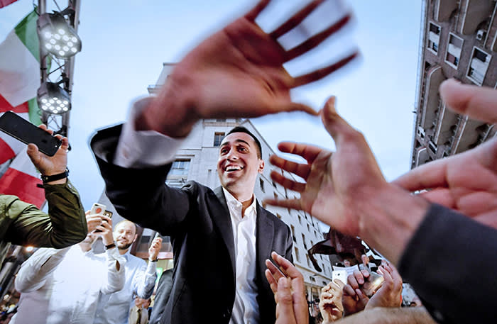 epa06771839 Five-Stars Movement (M5S) leader Luigi Di Maio (C) cheers with supporters during a meeting in Naples, Italy, 29 May 2018. Di Maio the previous day called for mass mobilisation in support of the party's bid to impeach President Sergio Mattarella the day after Mattarella refused to approve populist leaders' choice of an economy minister - namely Paolo Savona - who has expressed anti-euro views because the appointment would have 'alarmed markets and investors, Italians and foreigners. Mattarella spoke to reporters after Premier-Designate Giuseppe Conte, who was proposed as Prime Minister by Right-wing populist Lega and the populist Five Star Movement (M5S), announced that he did not succeed in forming what would have been Western Europe's first populist government. EPA/CIRO FUSCO