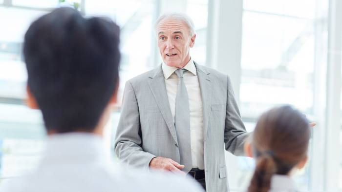 Cropped shot of a man addressing his employees during a presentation