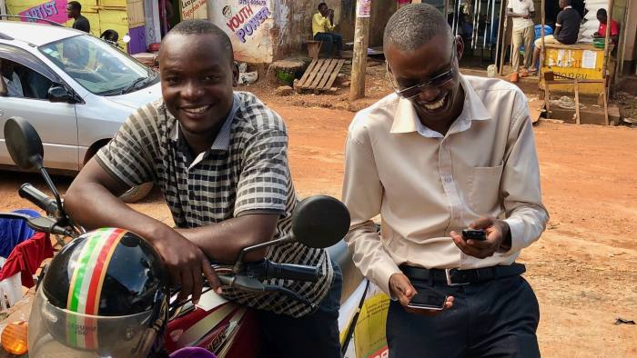 First Access - loan for the motorbike driver, and the other guy who is standing is a loan officer for a financial institution called UGAFODE that uses First Access software to do digital loan origination in Uganda