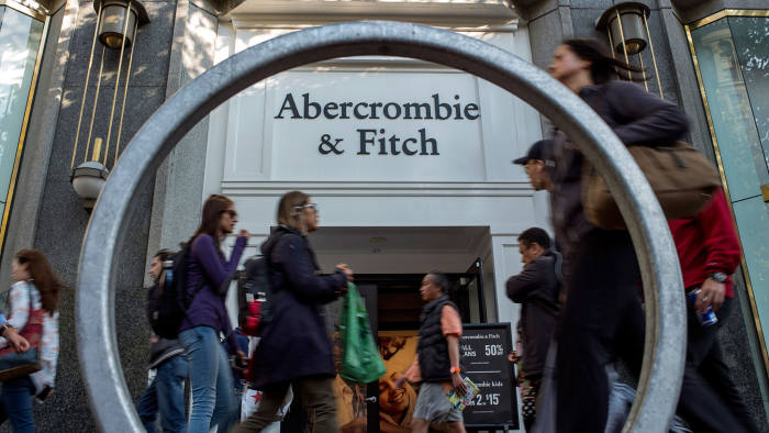 Pedestrians pass in front of an Abercrombie & Fitch Co. store in San Francisco, California, U.S., on Tuesday, Aug. 22, 2017. Abercrombie & Fitch Co. is scheduled to release earnings figures on August 24. Photographer: David Paul Morris/Bloomberg