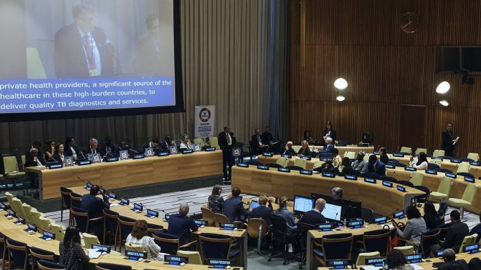 Bill Gates, center top, speaks during a High Level Meeting on Tuberculosis at U.N. headquarters, Wednesday, Sept. 26, 2018. (AP Photo/Andres Kudacki)