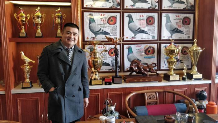 Pigeon fancier Chen Shiyi poses in his loft in Yiwu, eastern China