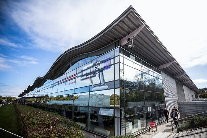 A graphic of a Dyson Cyclone V10 cord-free vacuum cleaner is displayed on the side of a building at the Dyson Group Plc campus in Malmesbury, U.K., on Wednesday, Sept. 26, 2018. Bagless vacuum cleaner inventor James Dyson is planning to move his company's headquarters to Singapore from Wiltshire, England, Chief Executive Officer Jim Rowan said in a January call with reporters. Photographer: Chris Ratcliffe/Bloomberg