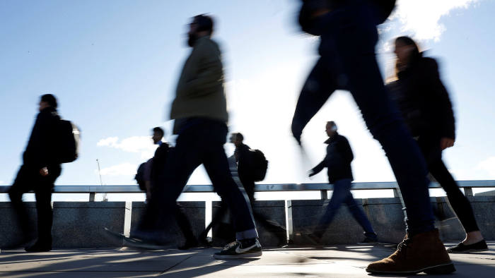 Workers walk across London Bridge as they head for the City of London, Britain, September 21, 2018. Picture taken September 21, 2018. To match Exclusive BRITAIN-EU/CITY REUTERS/Peter Nicholls