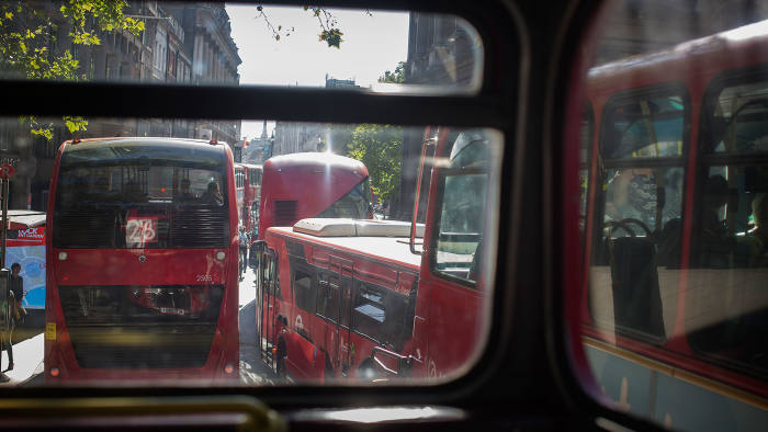 Rush-hour traffic inches toward the Strand in central London