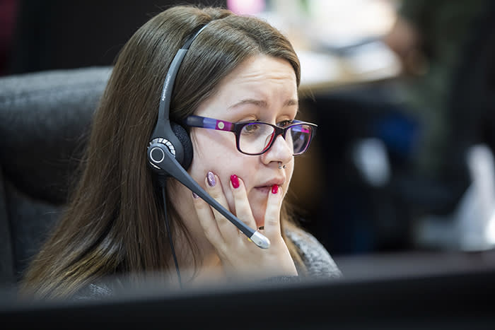 For The Financial Times. Feature on FT writer Claer Barrett on a visit to Payplan, a debt call centre in Grantham and listened in on customer calls. Pictured is Helpline Operator Shannon Nothdurft. Photo by Fabio De Paola