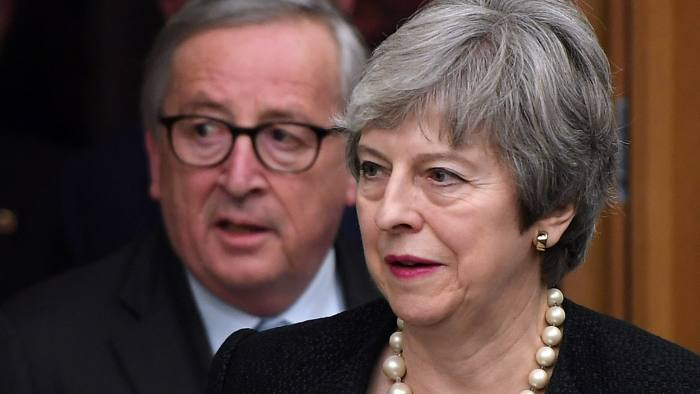European Commission President Jean-Claude Juncker (L) and British Prime Minister Theresa May arrive to give a press conference following their meeting in Strasbourg, on March 11, 2019. - The British government said on Monday it had agreed