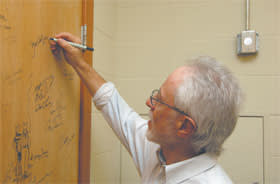 JM Coetzee signs the authors' door of the Ransom Center, University of Texas, May 2010