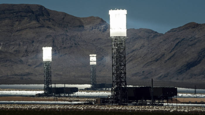 PRIMM, NV - JULY 23: The three towers at the Ivanpah Solar Electric Generating System are shown in operation on July 23, 2014 in the Mojave Desert in California near Primm, Nevada. The largest solar thermal power-tower system in the world, owned by NRG Energy, Google and BrightSource Energy, opened earlier this year in the Ivanpah Dry Lake and uses 347,000 computer-controlled mirrors to focus sunlight onto boilers on top of three 459-foot towers, where water is heated to produce steam to power turbines providing power to more than 140,000 California homes. (Photo by Ethan Miller/Getty Images)