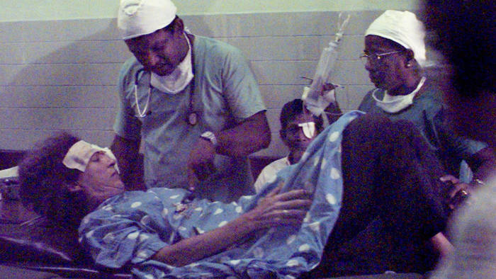 Medical staff examine Marie Colvin in the corridor outside the operating theatre in Colombo's eye hospital, Sri Lanka, in 2001