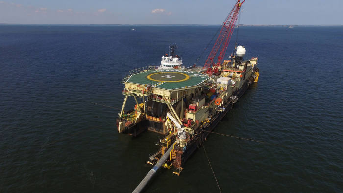 LUBMIN, GERMANY - AUGUST 16: In this aerial view the Castoro 10 pipelay vessel lays concrete-manteled pipe for the Nord Stream 2 gas pipeline onto the floor of the Baltic Sea on August 16, 2018 near Lubmin, Germany. The Nord Stream 2 pipeline will carry Russian natural gas from Vyborg in Russia to Greifswald in Germany, creating a new gas connection that bypasses countries such as Poland and Ukraine. (Photo by Sean Gallup/Getty Images)