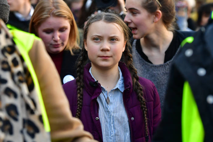 Swedish 16-years-old climate activist Greta Thunberg (C) takes part in a march for the environment and the climate organised by students, in Brussels, on Februaru 21, 2019. - Greta Thunberg, the 16-year-old Swedish climate activist who has inspired pupils worldwide to boycott classes, urged the European Union on February 21, 2019 to double its ambition for greenhouse gas cuts. (Photo by EMMANUEL DUNAND / AFP)        (Photo credit should read EMMANUEL DUNAND/AFP/Getty Images)