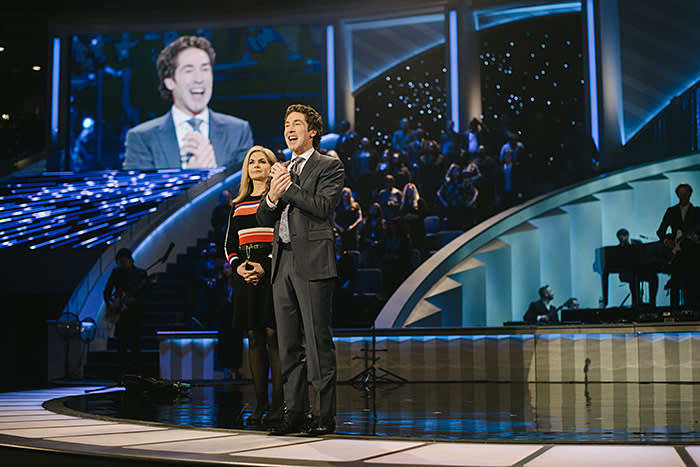 Joel Osteen and his wife Victoria greet Lakewood's 16,000-strong congregation