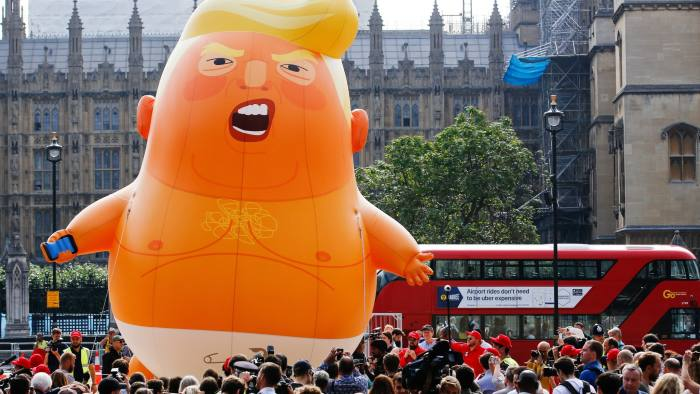 """The 'Trump Baby' blimp, a six meter-high helium-filled effigy of U.S. President Donald Trump, lifts off from Parliament Square in London, U.K., on Friday, July 13, 2018. Trump dealt a double blow to U.K. Prime Minister Theresa May, saying her plans for a soft Brexit would likely end hopes of a trade deal with the U.S. and that Boris Johnson, who quit her cabinet this week, would be a """"great"""" leader. Photographer: Luke MacGregor/Bloomberg"""