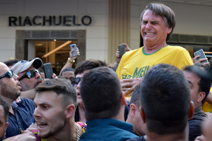 """Brazilian presidential candidate Jair Bolsonaro reacts after being stabbed during a rally in Juiz de Fora, Minas Gerais state, Brazil, September 6, 2018. REUTERS/Raysa Campos Leite SEARCH """"POY GLOBAL"""" FOR FOR THIS STORY. SEARCH """"REUTERS POY"""" FOR ALL BEST OF 2018 PACKAGES. TPX IMAGES OF THE DAY."""